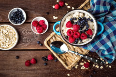 Oatmeal porridge with fresh berries, oats with blueberry and raspberry Stock Photos