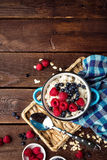Oatmeal porridge with fresh berries, oats with blueberry and raspberry Royalty Free Stock Image