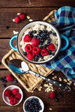 Oatmeal porridge with fresh berries, oats with blueberry and raspberry Royalty Free Stock Images