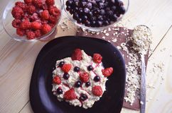 Oatmeal porridge with fruit. Tasty vegetarian food royalty free stock photography
