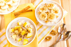 Oatmeal porridge with fruits and nuts Royalty Free Stock Image
