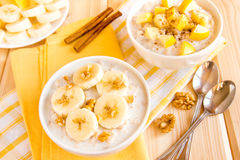 Oatmeal porridge with fruits and nuts Stock Image