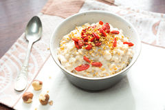 Oatmeal porridge with goji berries and linseed in bowl Stock Photo