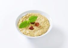Oatmeal porridge with hazelnuts Stock Photo
