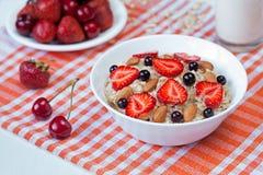 Oatmeal porridge helathy breakfast with strawberry Stock Images