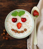 Oatmeal porridge with milk and  berries- healthy Stock Photography