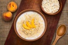 Oatmeal Porridge with Peach Stock Photo