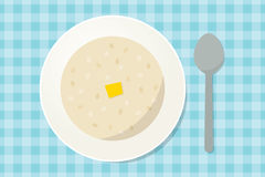 Oatmeal porridge with a piece of butter in a plate Stock Photo