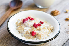 Oatmeal porridge with raspberries in bowl Royalty Free Stock Image