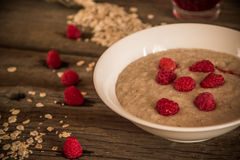 Oatmeal porridge with raspberries Stock Photography