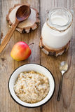 Oatmeal porridge with raspberry and milk, healthy breakfast Stock Image