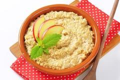 Oatmeal porridge with sliced apple Stock Photo