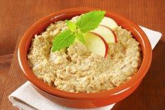 Oatmeal porridge with sliced apple Royalty Free Stock Image