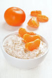 Oatmeal porridge with slices of tangerines Royalty Free Stock Images