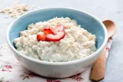 Oatmeal porridge with strawberries in a bowl. Oats porridge bowl. Healthy eating, healthy lifestyle, dieting concept Stock Photography