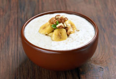 Oatmeal porridge with walnuts and bananas Stock Images