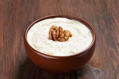 Oatmeal porridge with walnuts Royalty Free Stock Photos