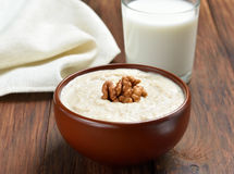 Oatmeal porridge with walnuts Royalty Free Stock Images