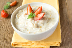 Oatmeal porrige with berries Royalty Free Stock Images