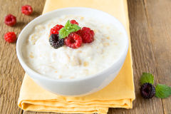 Oatmeal porrige with raspberry Stock Photos