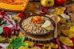 Oatmeal with pumpkin Stock Photos