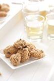 Oatmeal raisin cookies. Delicious and freshly baked oatmeal raisin cookies with tea Royalty Free Stock Photos