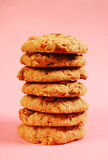 Oatmeal raisin cookies. Stack of oatmeal raisin cookies against pink background Stock Photography
