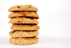 Oatmeal raisin cookies. Stack of oatmeal raisin cookies against white background Royalty Free Stock Photo