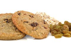 Oatmeal Raisin Cookies. With raw oatmeal and raisins in the background Royalty Free Stock Photo