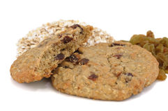 Oatmeal Raisin Cookies. With raw oatmeal and raisins in the background Stock Images