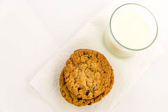 Oatmeal raisin cookies and glass of milk Royalty Free Stock Images