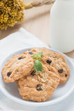 Oatmeal and raisin cookies with milk. Stock Photography