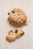 Oatmeal and raisin cookies on wood. Royalty Free Stock Photo