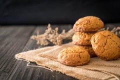 Oatmeal raisin cookies on wood Stock Image