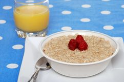Oatmeal with raspberries Stock Photography