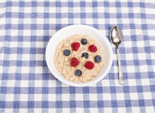 Oatmeal with Raspberries and Blueberries Royalty Free Stock Photo