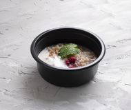 Oatmeal with raspberries and curd in eco food container stock photo