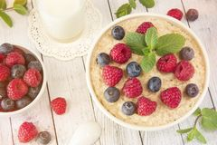 Oatmeal with raspberries.Healthy food for breakfast.Tasty oatmea. Healthy food for breakfast.Oatmeal with raspberries.Tasty oatmeal with berries in bowl on table Royalty Free Stock Photography