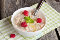Oatmeal with raspberries and honey, top view. Oatmeal with raspberries and honey, horizontal, close up Royalty Free Stock Image