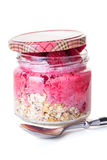 Oatmeal with raspberries in a jar. On white background Stock Images