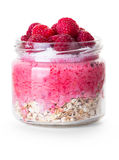 Oatmeal with raspberries in a jar. On white background Stock Photo