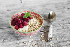 Oatmeal with raspberries and natural yoghurt in a bowl Stock Image