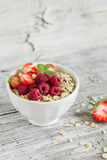 Oatmeal with raspberries, strawberries and natural yoghurt in a bowl Stock Photos