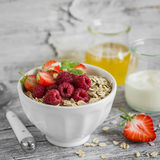 Oatmeal with raspberries, strawberries and natural yoghurt in a bowl Stock Images