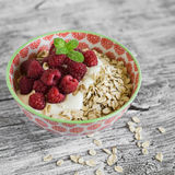 Oatmeal with raspberries, strawberries and natural yoghurt in a bowl Royalty Free Stock Image
