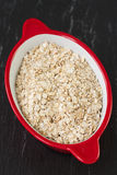 Oatmeal in red bowl Royalty Free Stock Photos