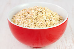 Oatmeal in red bowl Royalty Free Stock Image