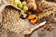 Oatmeal in a sac, ears of oats, dried apricots, raisins, grapes, Stock Image