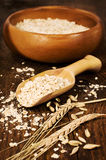 Oatmeal with a scoop of wheat spikelets Stock Images