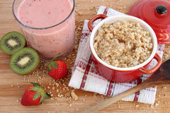 Oatmeal and smoothie Stock Images